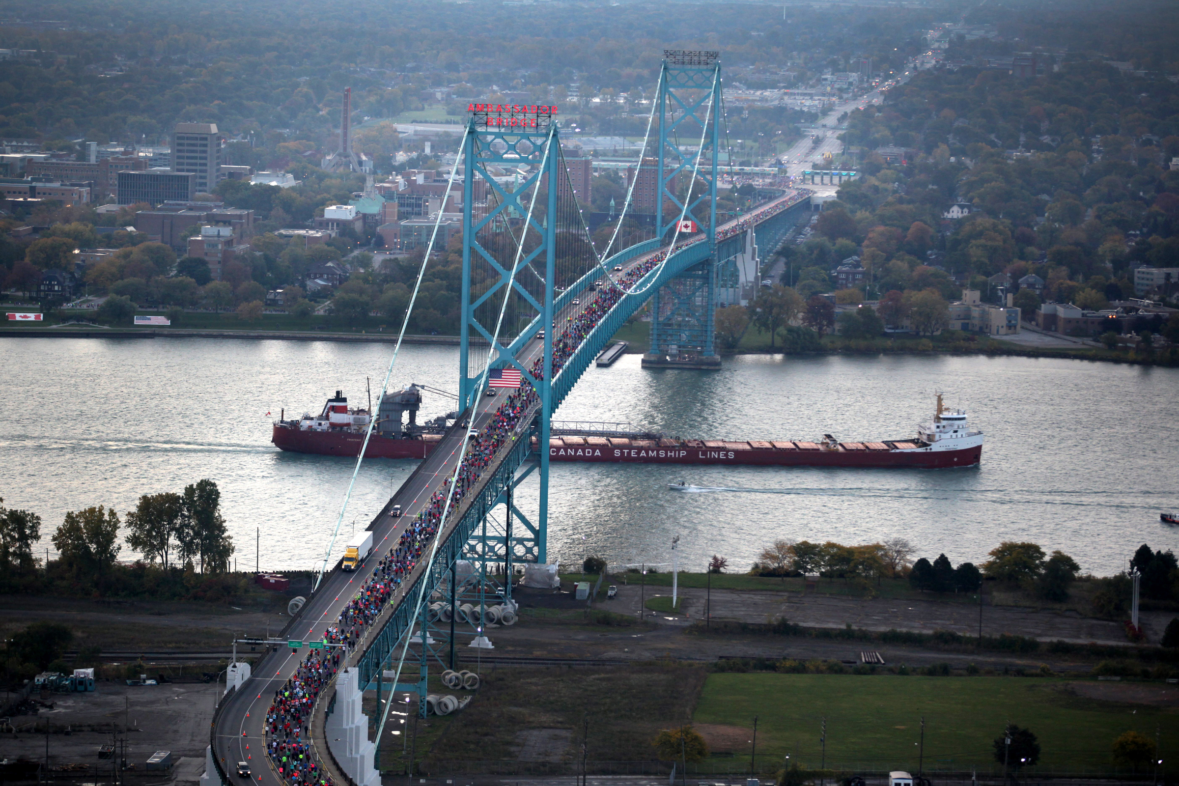 Detroit Marathon image of runners crossing the Ambassador Bridge into Windsor, Ontario Canada.